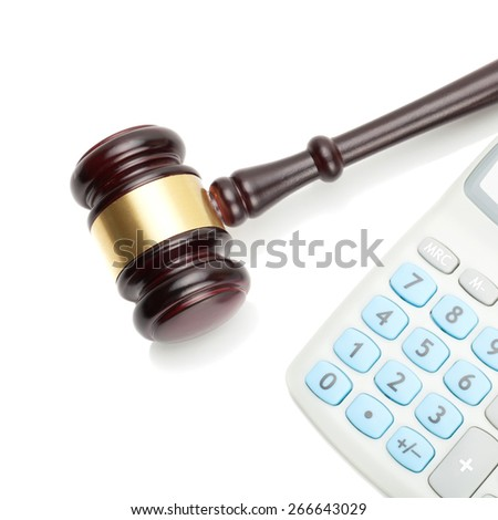 Judge's gavel and calculator next to it - close up shot - stock photo