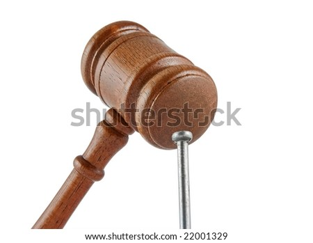 Judge's gavel and nail isolated on white