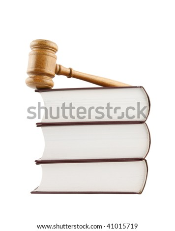 Judge's gavel and stack of legal books isolated on white - stock photo