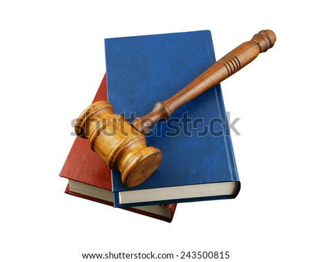 Judge's gavel on legal books isolated on white  - stock photo