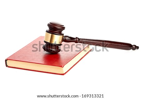 Judge's gavel on red legal book - stock photo