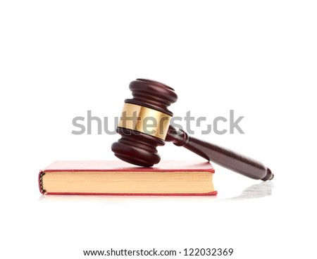 Judge's gavel on red legal book isolated - stock photo