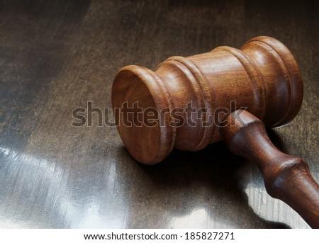 Judge's gavel on table  - stock photo