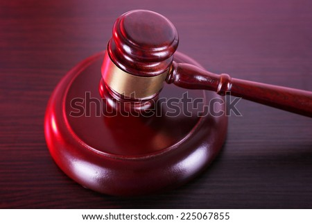 Judge's gavel on table - stock photo