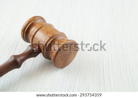 Judge's gavel on table with room for text - stock photo
