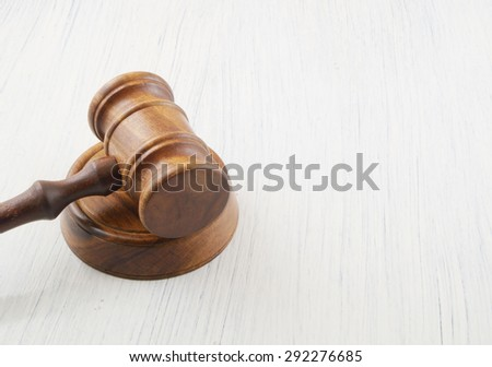 Judge's gavel on white table with copyspace - stock photo