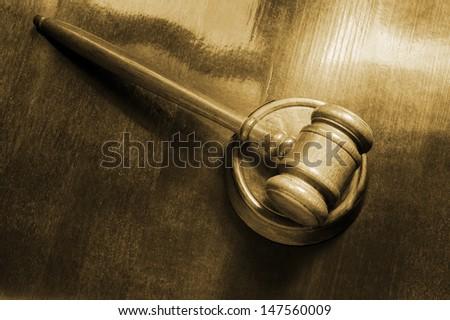 Judge's gavel on wooden background - stock photo