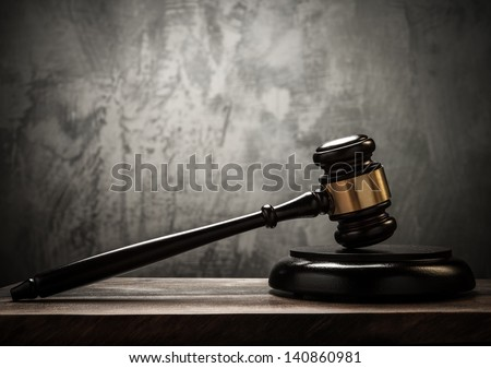 Judge's hammer on wooden table