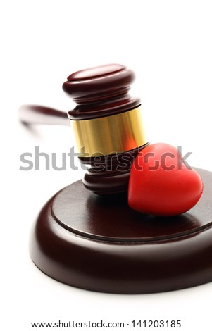 Judge's wooden gavel and red heart