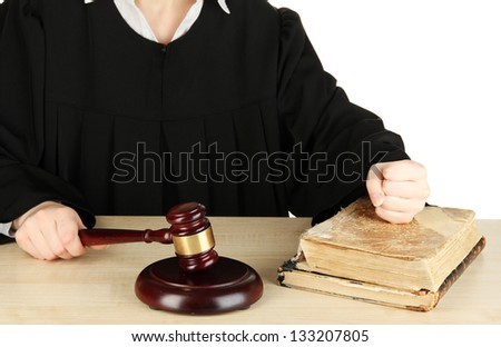 Judge sitting at table during court hearings isolated on white - stock photo
