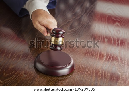 Judge Slams His Gavel and American Flag Table Reflection. - stock photo