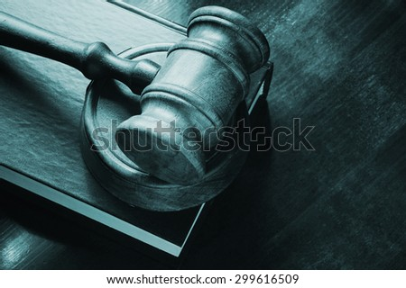 Judge wooden gavel and legal book on wooden table - stock photo