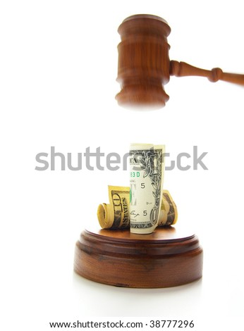 judges gavel about to pound on money - stock photo