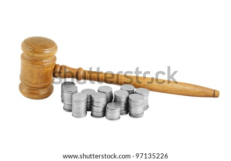 Judges gavel and coins isolated on white - stock photo
