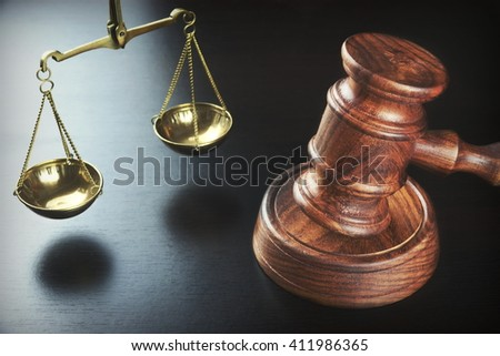 Judges Gavel And Scale Of Justice On The Black Table, Top View. - stock photo