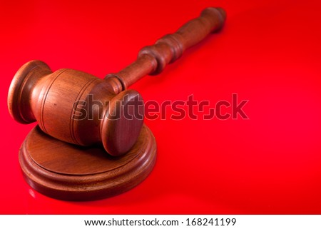 Judges gavel on a red background - stock photo