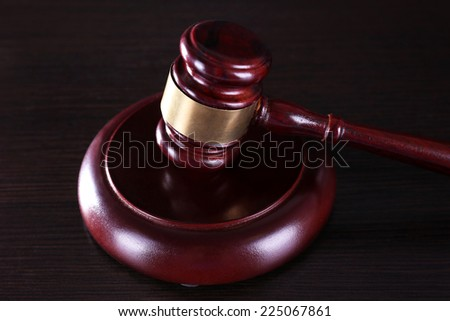 Judges gavel on table - stock photo