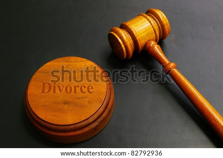 judges gavel with divorce text, on black - stock photo