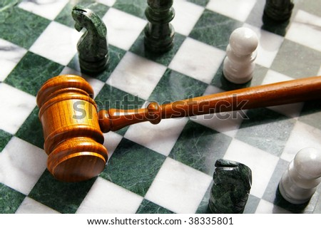 judges law gavel on a chess board, from above - stock photo