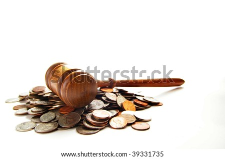 judges law gavel on a pile of coins, over white - stock photo