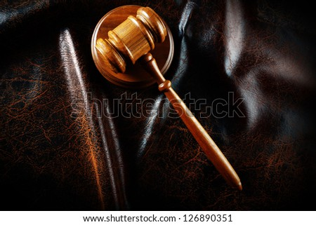 Judges legal gavel in dramatic light from above - stock photo