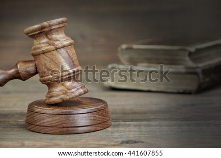 Judges Or Auctioneer Gavel And Old Shabby Law Book On Rough Wood Table, Close Up, Justice Or Auction Bidding Concept - stock photo