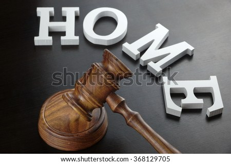 Judges Or Auctioneer Gavel And White Sign Home Made From Wooden Letter On Black Wood Table  Background In Back Light, Close Up, Conceptual Image. - stock photo