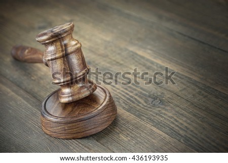 Judges Or Auctioneer Wooden Gavel Or Hammer On Old Wooden Table, Trial Concept, Auction Concept, Bidding, Close Up - stock photo