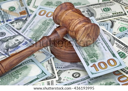Judges or Auctioneers Gavel Or Hammer On Huge Heap Of Money On Wooden Table, Concept for Trial, Concept For Auction, Close Up, - stock photo