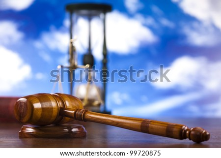 Judges wooden gavel, and bluse sky - stock photo