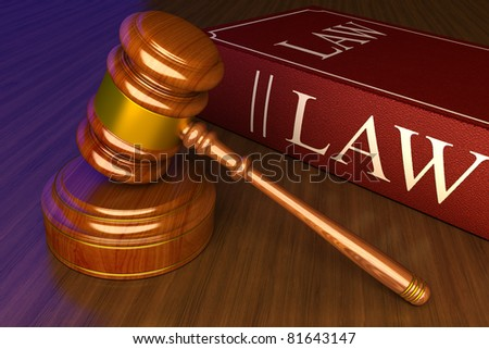 judicial gavel against the book of the law - stock photo