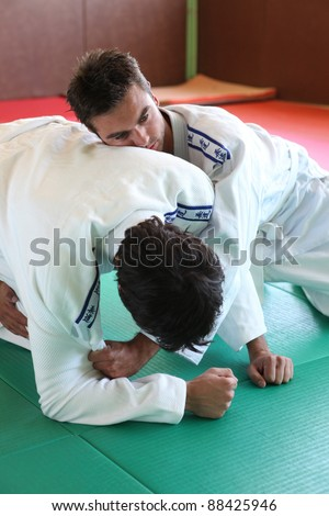Judo hold down. - stock photo