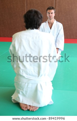judokas on tatami - stock photo