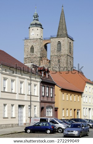 Jueterbog, Brandenburg, Germany - April 23, 2011: The towers of Saint Nicholas church in the historical town centre the German city of Jueterbog in Brandenburg.