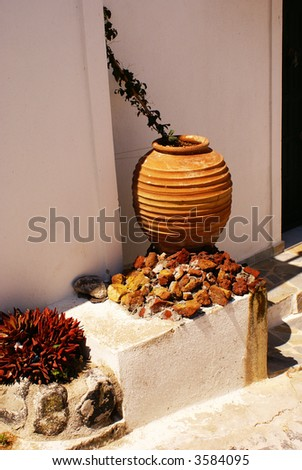 Jug and flowers - stock photo