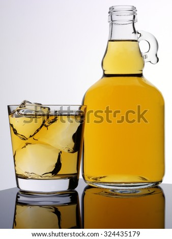 JUG AND GLASS OF CIDER - stock photo