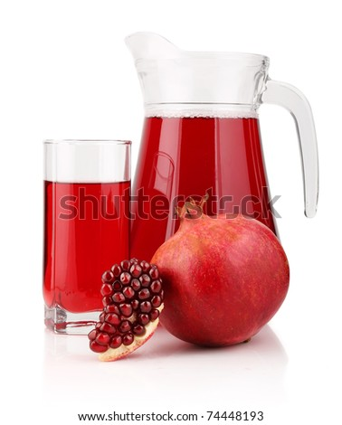 Jug and glass of  pomegranate juice with fruits isolated on white background - stock photo