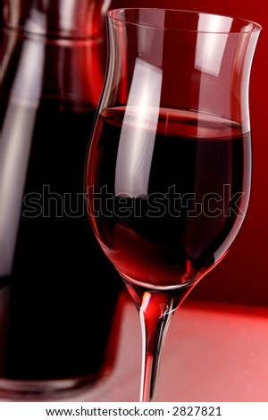 jug and glass of red wine