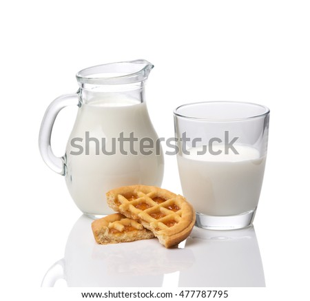 Jug and glass with milk and cookies with jam isolated on white background