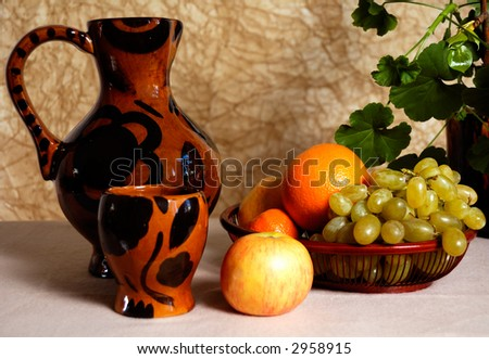jug, bowl and fruits in basket