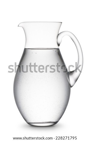 jug full of natural water, on white background - stock photo