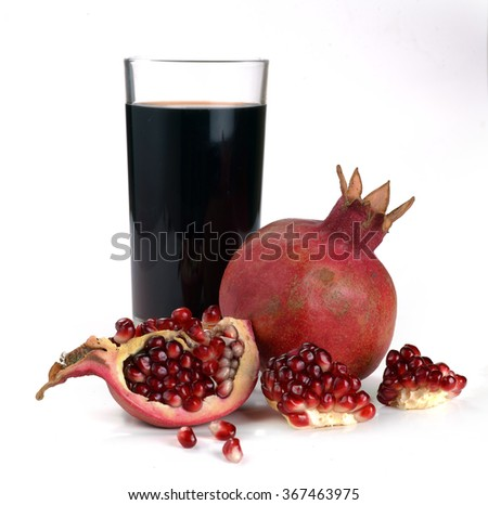 Jug of juice and ripe piece grenade on white background