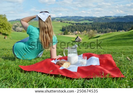 Jug of milk on the Swiss flag. Emmental, Switzerland - stock photo