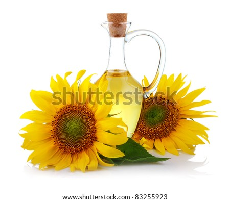 Jug of sunflower oil with flowers isolated on white background - stock photo