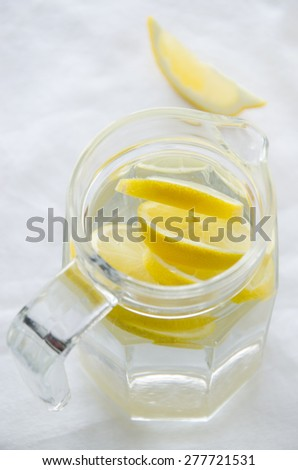Jug of water with lemon