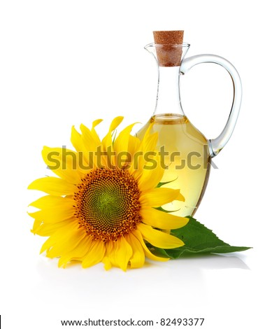 Jug sunflower oil with flower isolated on white background - stock photo