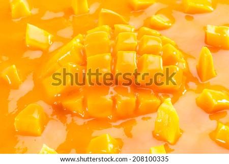 Juice and slice of Alphonso Mango - stock photo