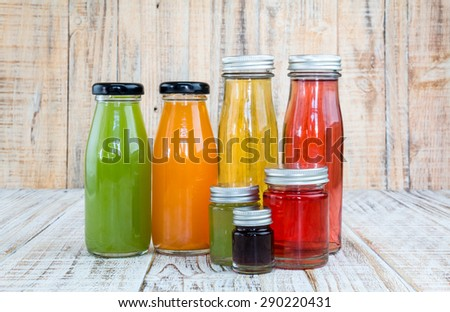Juice bottle on wooden background