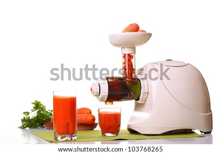 Juice extractor and carrot isolated white kitchen prepare - stock photo
