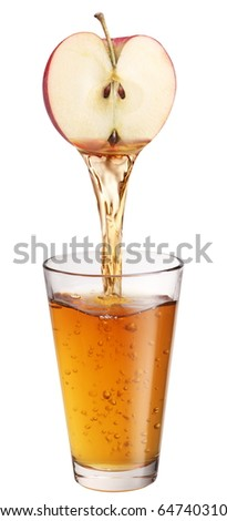 Juice flowing from apple into the glass. - stock photo